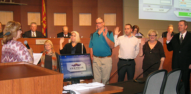 Board swearing in new member