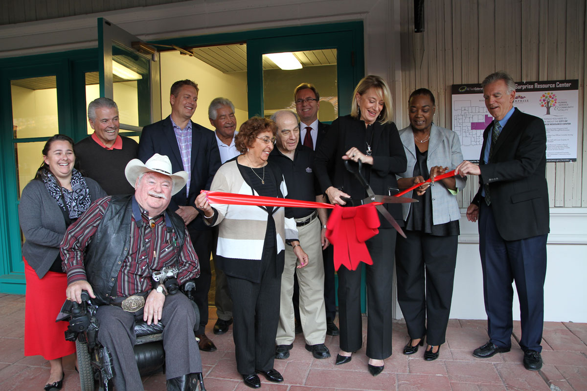 Surprise City Council member cutting ribbon at new CAP office