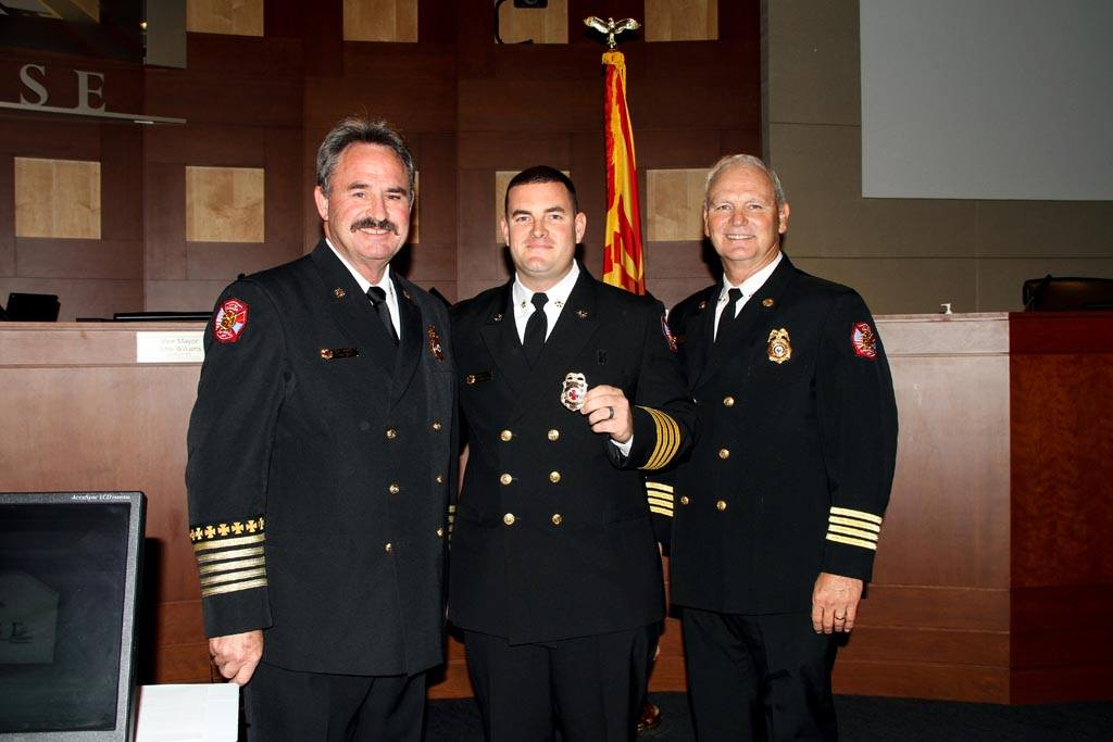 Chief Tom Abbott & Asst. Chief Darrell Johnston with newly promoted Asst. Chief Brenden Espie