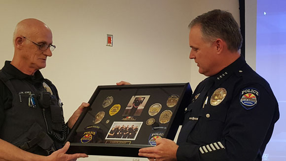Chief Terry Young with retiring Officer John Jones