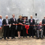 members IRIS USA and Surprise City Council cutting opening ribbon