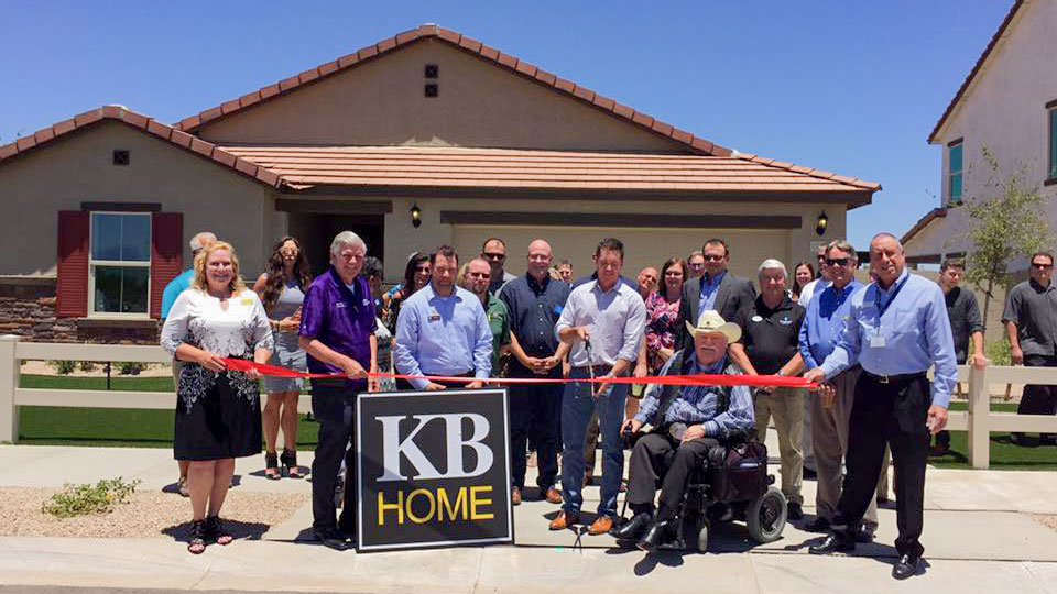 Councilman Winter and members of KB Homes cut ribbon in front of one of their model homes