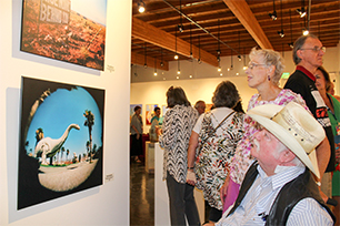 Councilemember Winters and his wife looking at the beautiful work of Muriel Sawicki