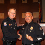 Surprise Police Chief Terry Young congratulating Sergeant Joseph Kopronica