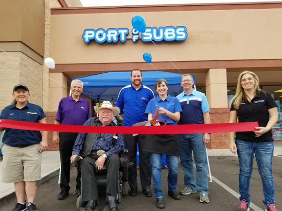 Councilmembers Skip Hall, Patrick Duffy and Roland Winters at the ribbon cutting for the Port of Subs restaurant