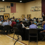 Guests seated at tables during the Luncheon