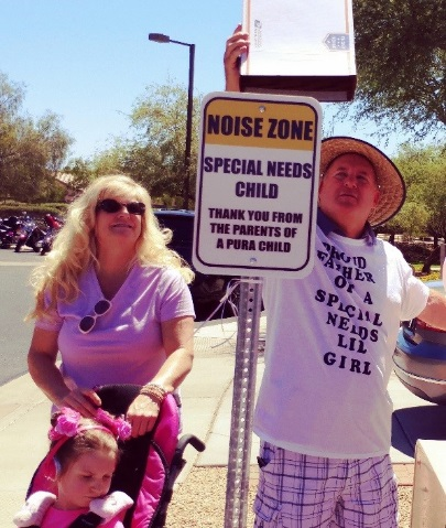The Collins Family revealing the Noise Zone signs for special needs children