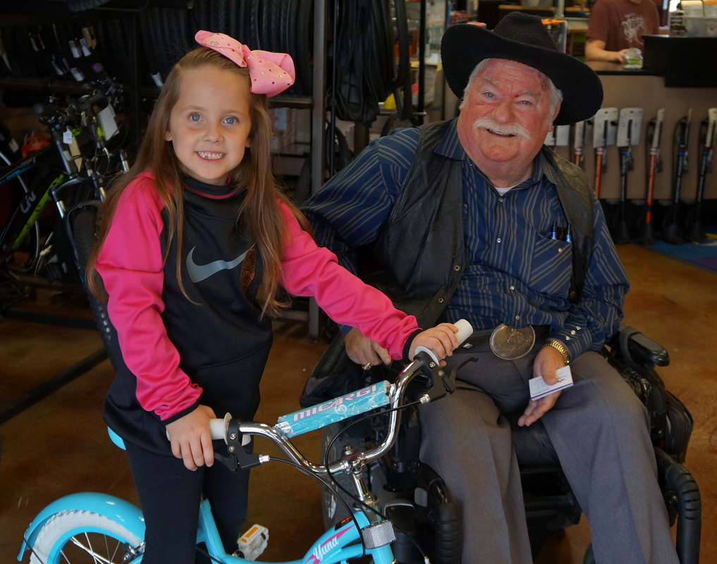 Raelyn, the Winner of the bike raffel and Councilman Winters at the Surprise PD Bike Rodeo