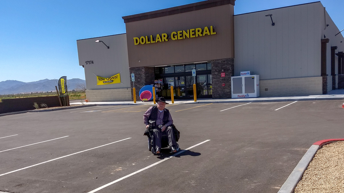 Councilmember Winters in front of new Dollar General