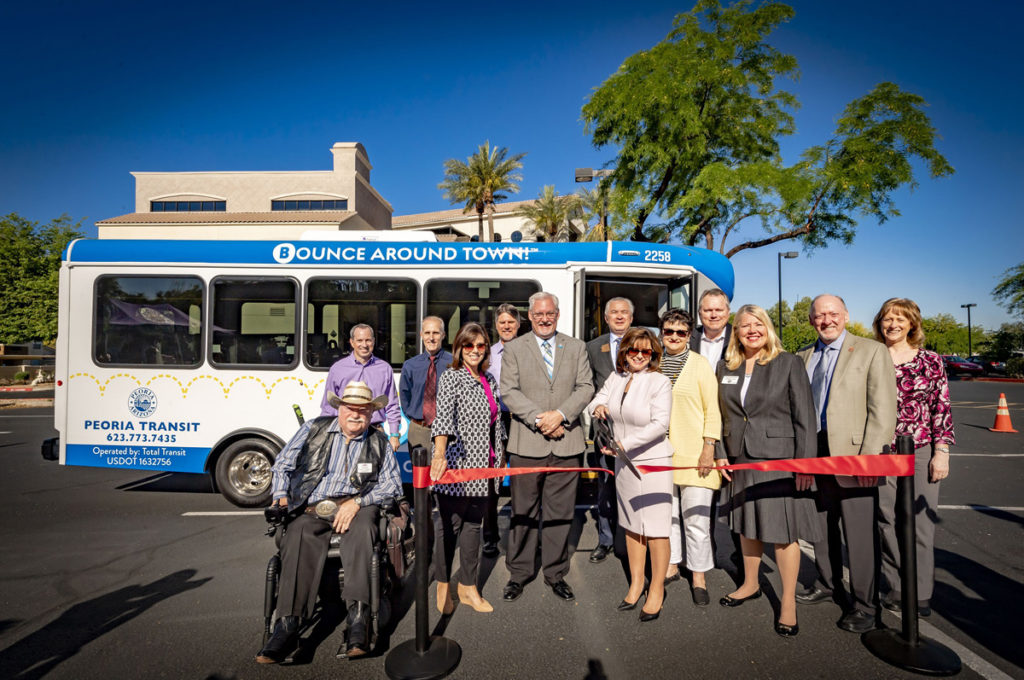 group ribbon cutting of new Peoria POGO bus