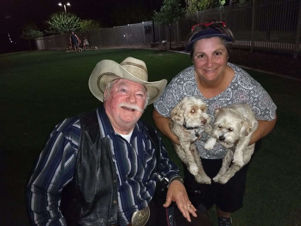 Vice Mayor Winters with a City of Surprise resident and her dogs at Dick McComb Park.