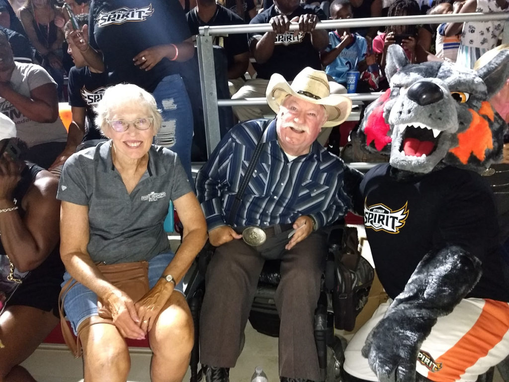 Vice Mayor Winters and the Ottawa mascot at an Ottawa University football homegame.