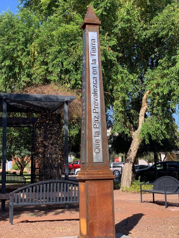 A peace pole at City Hall across the street from the police department.