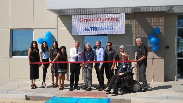 Mayor Hall prepares to cut the ribbon at the Trimaco grand opening ceremony alongside City of Surprise Councilmembers.