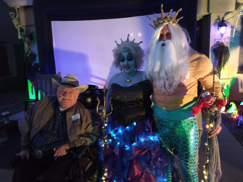 Vice Mayor Winters on Halloween with residents of Royal Ranch, dressed as Ursula and King Triton from The Little Mermaid.