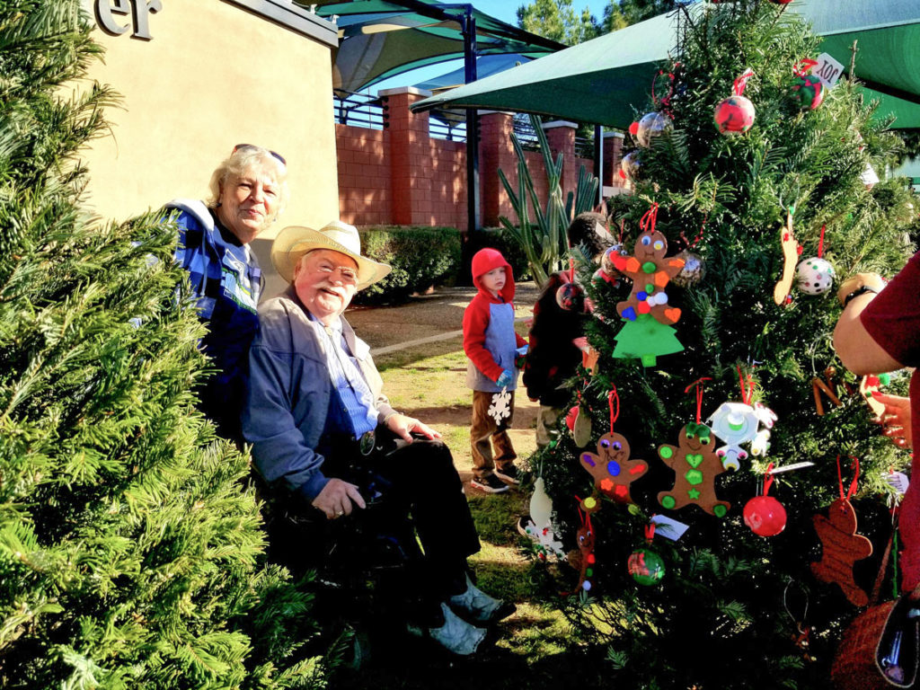 Vice Mayor Winters next to a decoration adorned tree at Surprise's adaptive park.