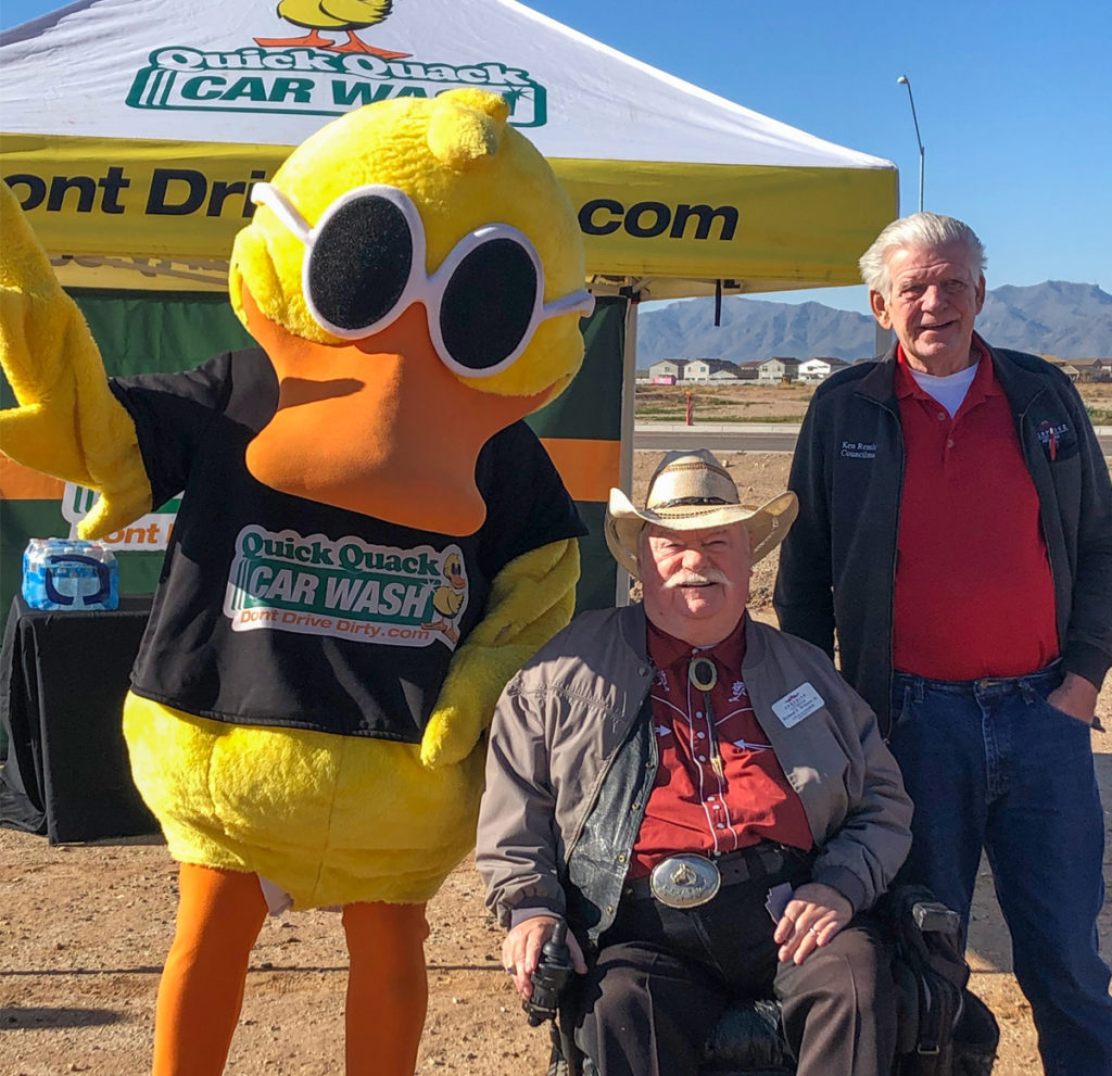 Councilmember Winters, Councilmember Remley and the Quick Quack Car Wash mascot.
