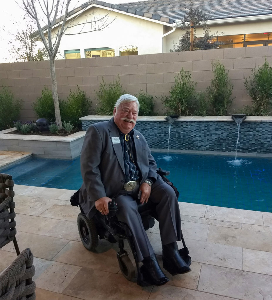 Councilmember Winters in the backyard of a Toll Brothers model home.