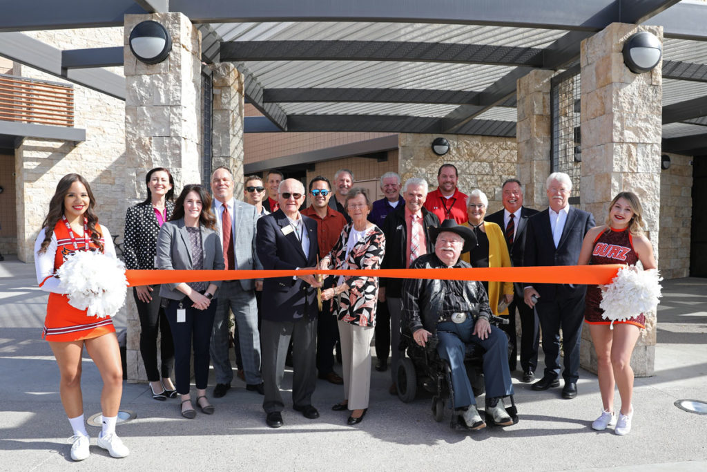 An orange ribbon is cut for the Ottawa O'Dell Center's grand opening ceremony outside the new facility.
