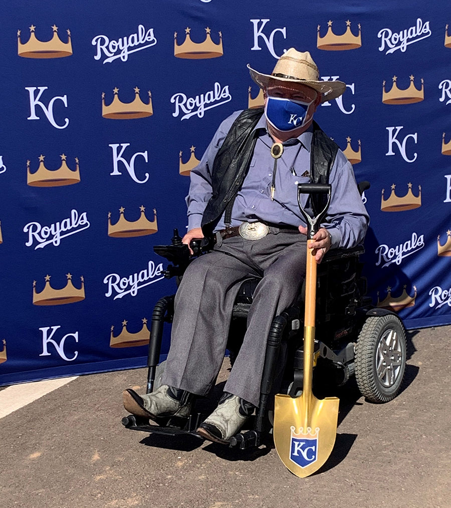 Councilmember Winters holding a Kansas City Royals golden shovel.
