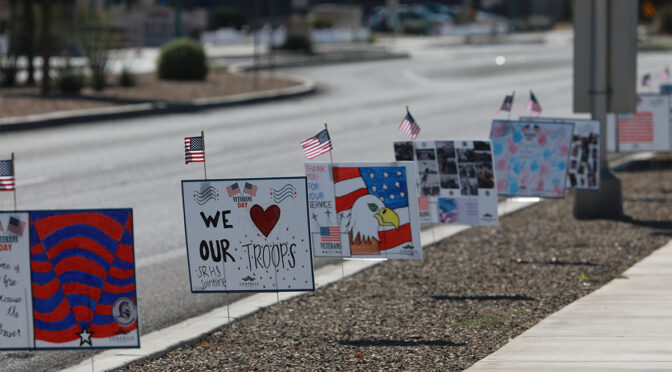 Hand made Veterans Day signs from the community, posted along Bullard Avenue.