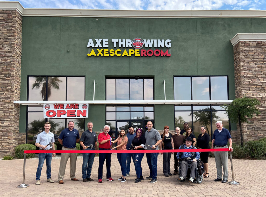 Surprise City Council cuts a red ribbon outside of Axescape Room for their grand opening.