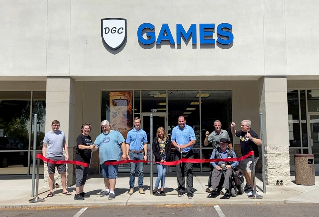 Surprise City Council cuts a red ribbon outside of Dungeon Gaming Center for their grand opening.