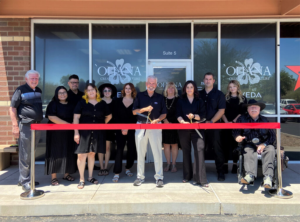 Mayor Hall, Councilmember Winters, and Councilmember Remley cut a red ribbon outside of Ohana for their grand opening.