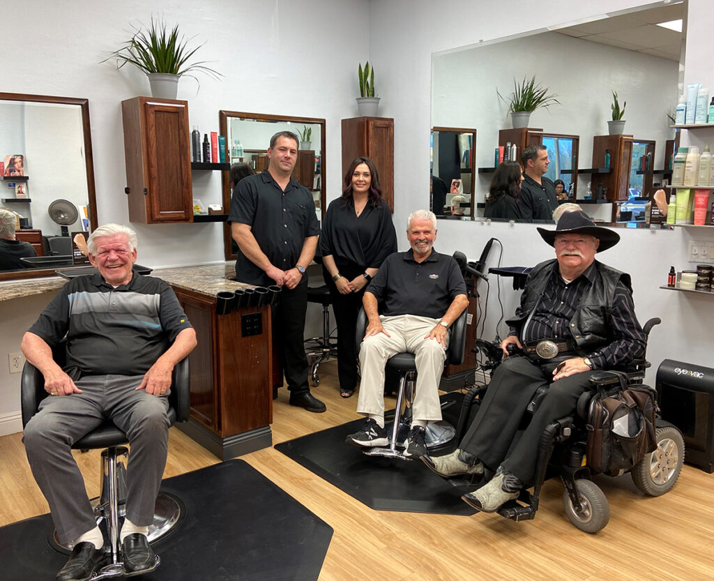 Mayor Hall, Councilmember Winters, and Councilmember Remley sit in the salon chairs inside Ohana Salon.