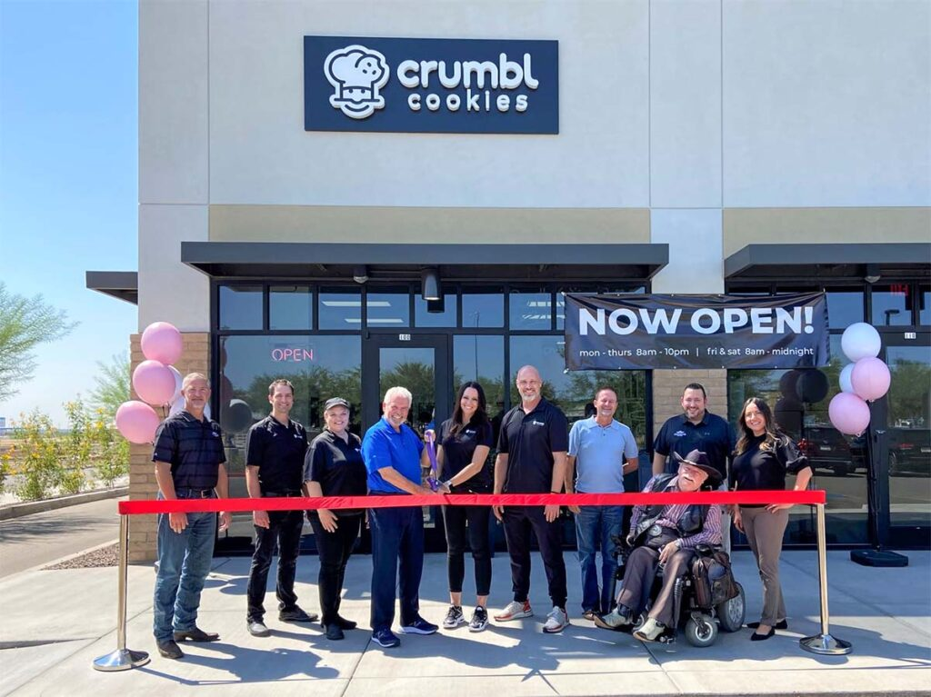 Surprise City Council and the owners of Crumbl Cookies in Surprise cut a grand opening ribbon.