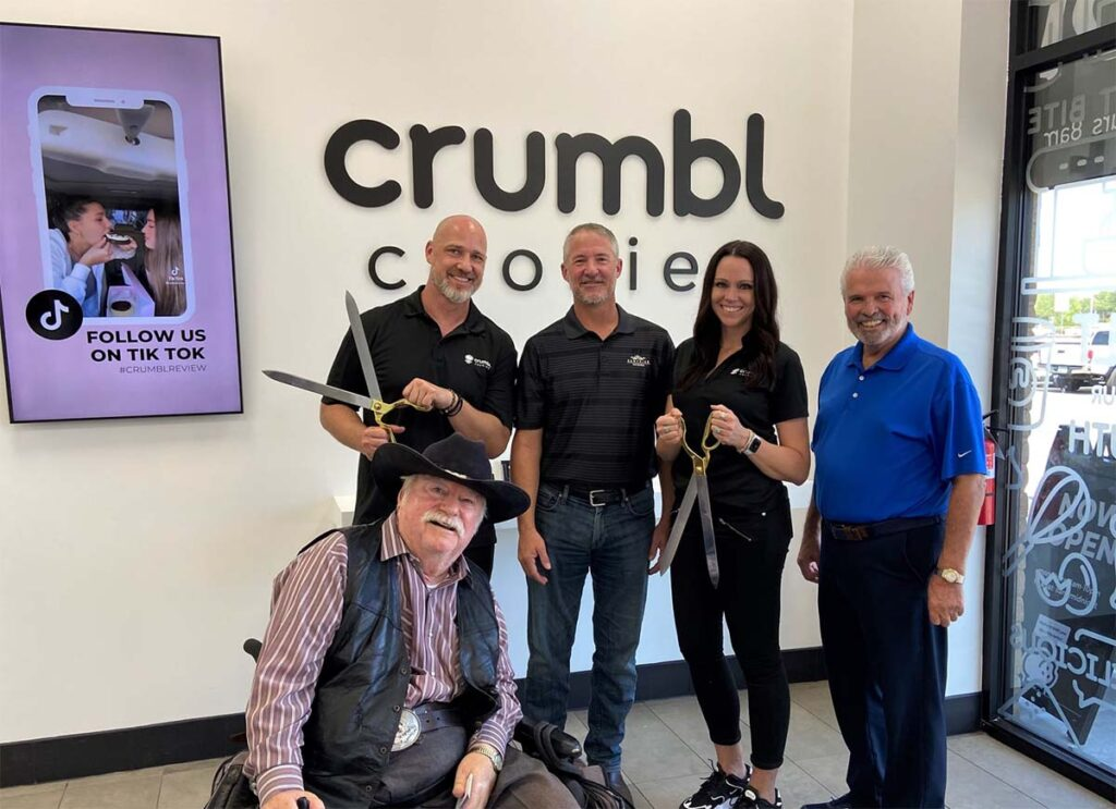 Mayor Hall, Councilmember Winters, Councilmember Judd, and the owners of Crumbl Cookie in Surprise.